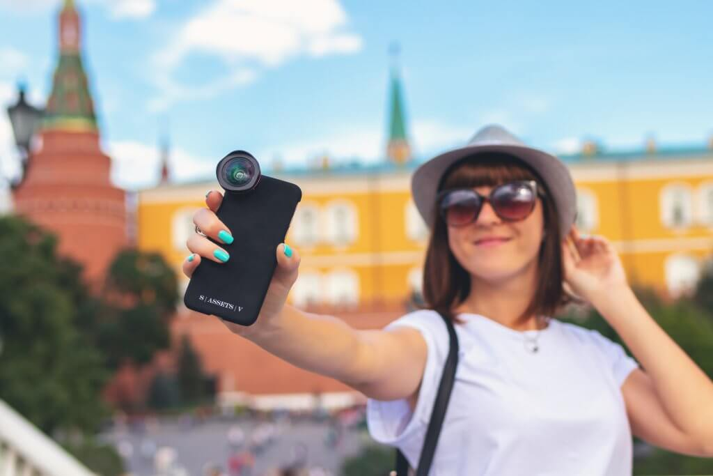 hat wearing woman taking a selfie while on vacation
