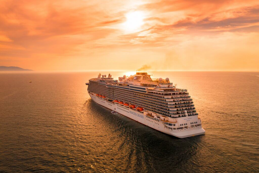 cruiseship sailing off into the sunset in mexico