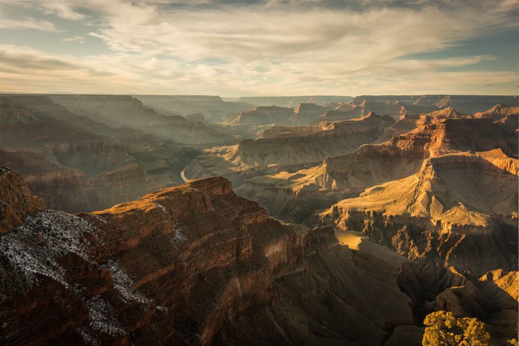 the sun rising over grand canyon national park