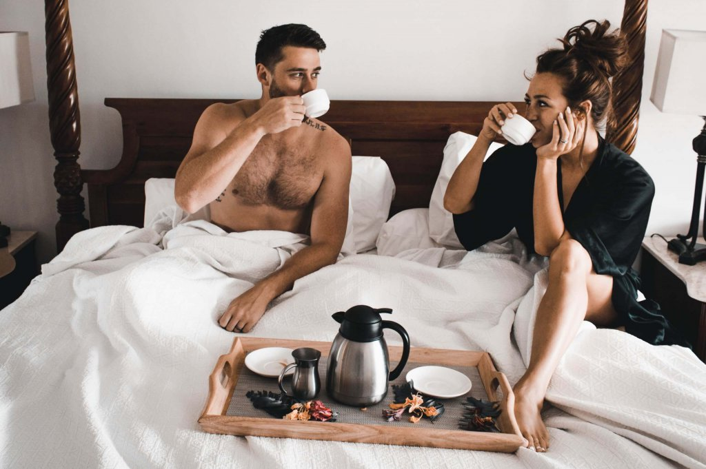 couple drinking morning coffee in a bed
