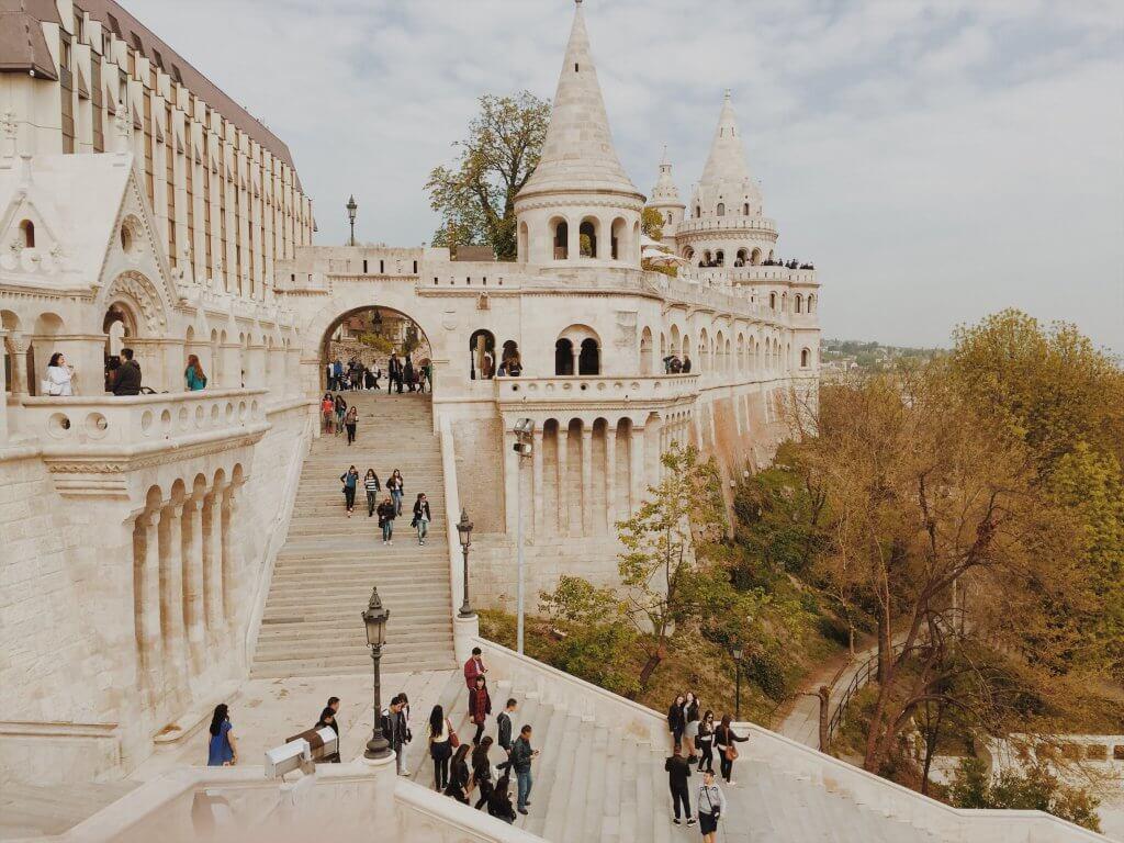People walking down castle steps