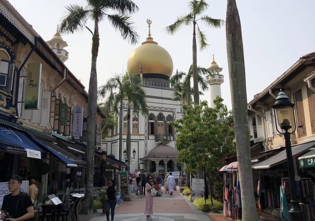 people pass in front of Sultan Mosque on Arab street in Singapore