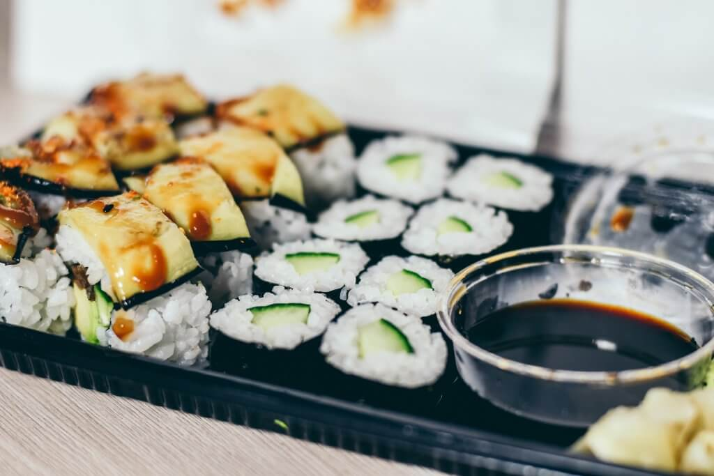 close up of a sushi takeout container