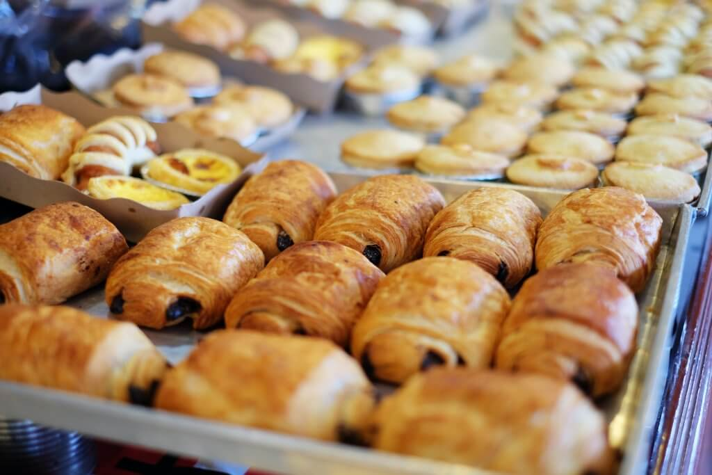 tray of pan au chocolat in a bakery display case