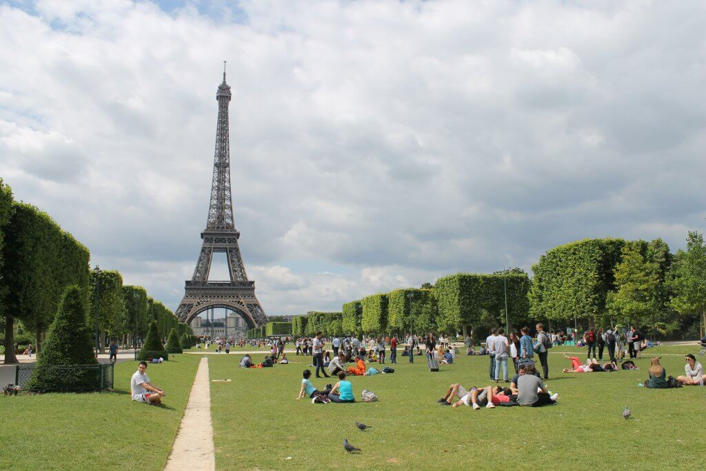 people having a picnic in paris, france with the Eiffel Tower in the background