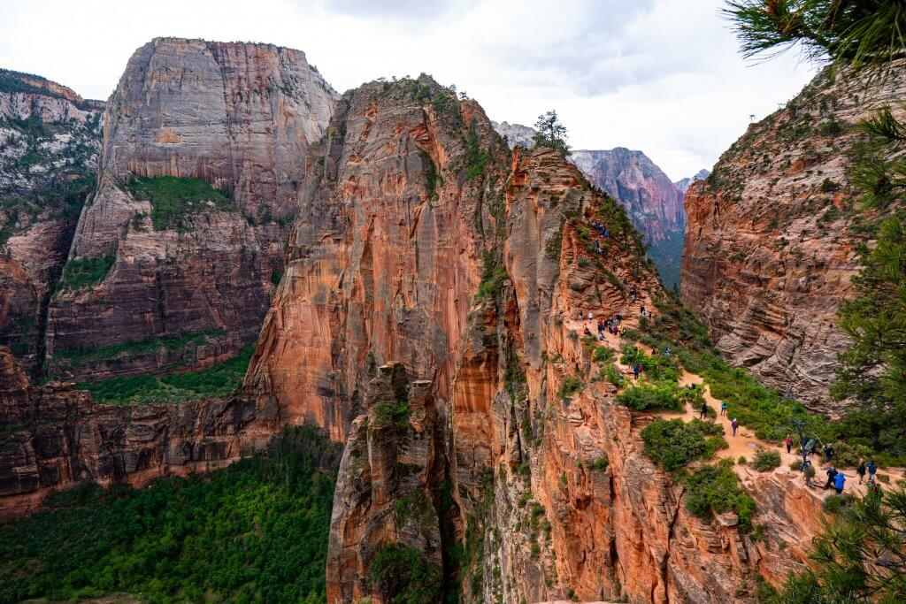 hikers traverse over the narrow trail at Angels Landing