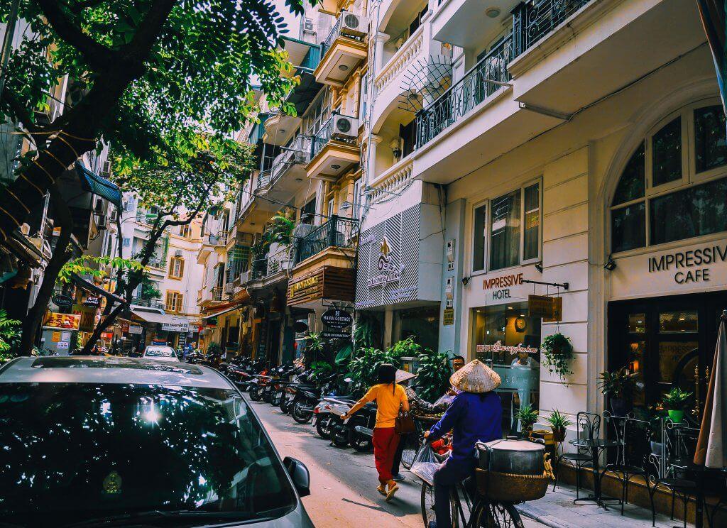 women walking through Hanoi old quarter