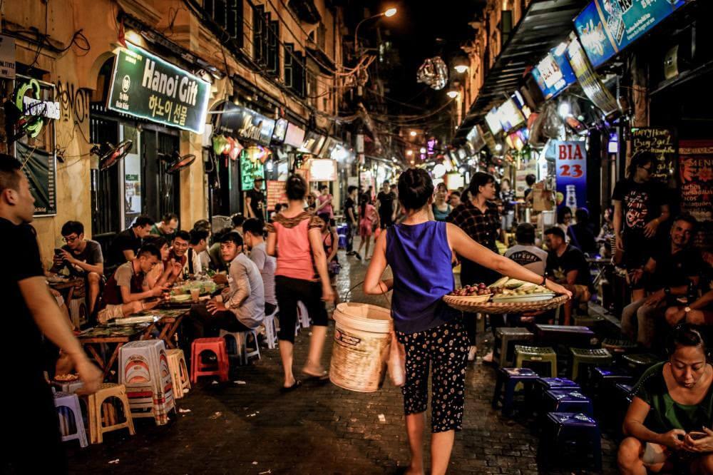 woman selling goods outside hanoi bars