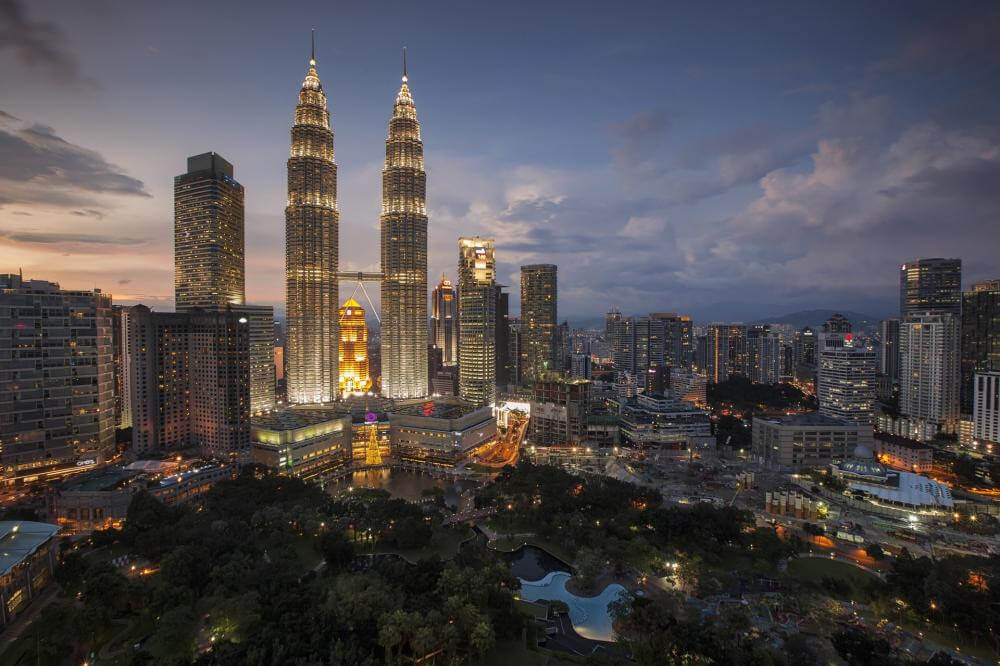 far away view of the petronas towers and KL skyline