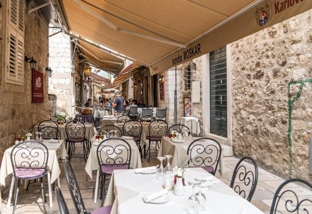outdoor dining area in a narrow alley in Croatia