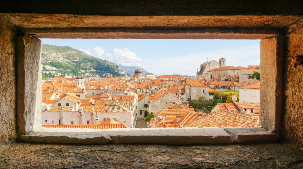 view of red tile roofs from a window along Dubrovnik's old city walls