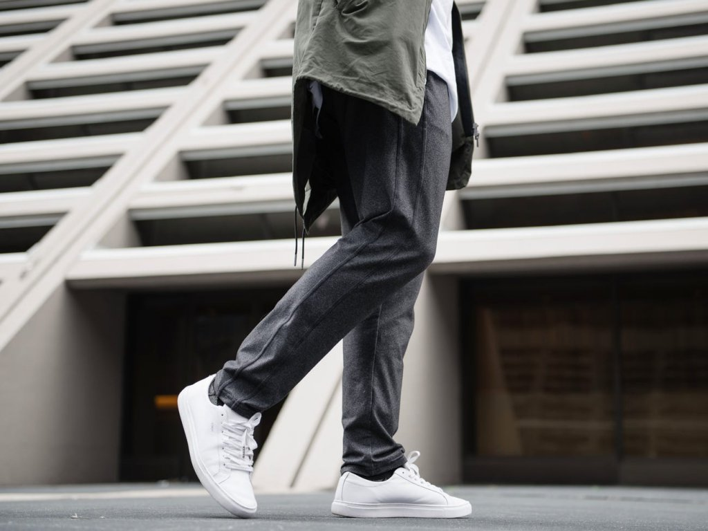 man walking in the best travel pants from public rec